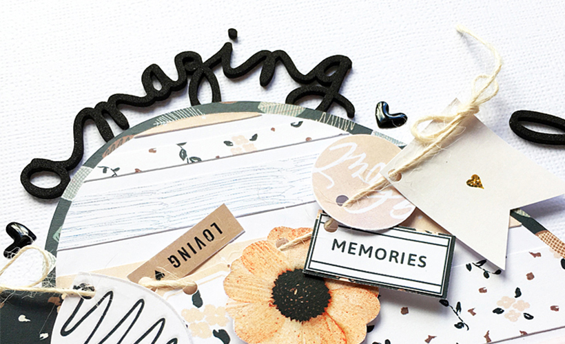 Using pre-made embellishments in scrapbook layouts